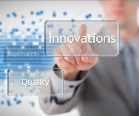 Businessman standing behind the word innovation against blue background photo