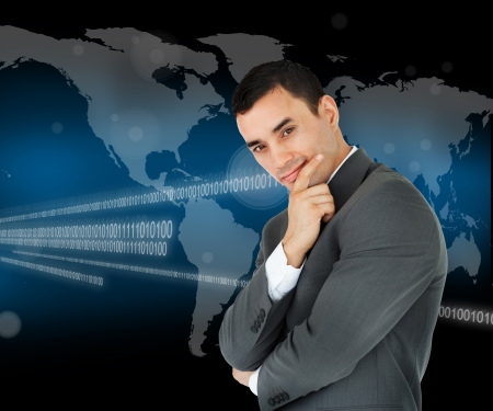 smug: Businessman standing in front of a world map and binary code while smiling