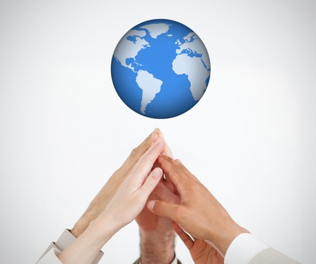 People joining and reaching hands up to a globe  photo