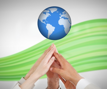 People reaching hands up to a globe against white background with green wave photo
