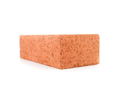 out of context: Red construction brick on white background