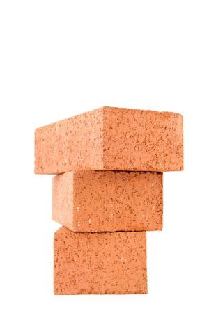 Stack of three clay bricks against white background photo