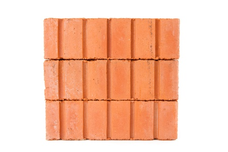 Stack of clay bricks in a wall against a white background Stock Photo - 16068502