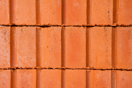 Stack of red clay bricks buldiing a wall Stock Photo - 16068829
