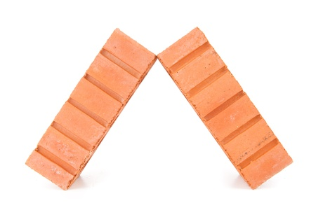 out of context: Two clay bricks leaning against each other with a white background Stock Photo
