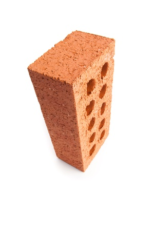 out of context: Standing red brick with ten holes against a white background