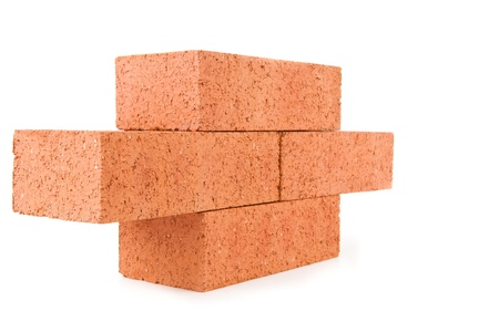 Four clay bricks stacked as a part of a wall against a white background Stock Photo - 16068452
