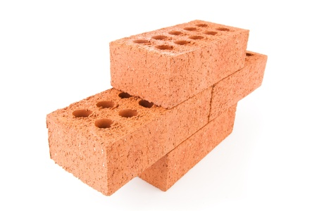Four clay bricks stacked as a part of a wall against a white background photo