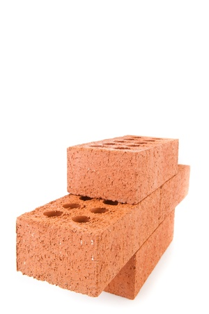 Four clay bricks from the side stacked as a part of a wall against white background photo