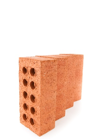out of context: Four clay bricks positioned in a row against a white background