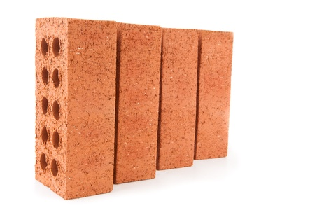 Four red bricks positioned in a row with a white background Stock Photo - 16068635