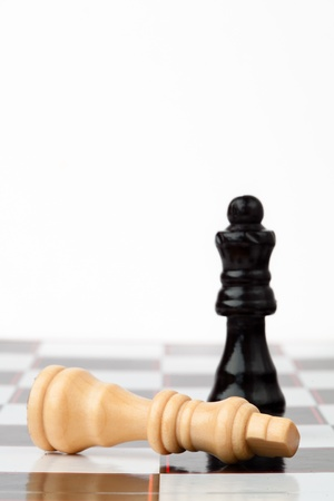 chessmen: White and black chess pieces at the chessboard
