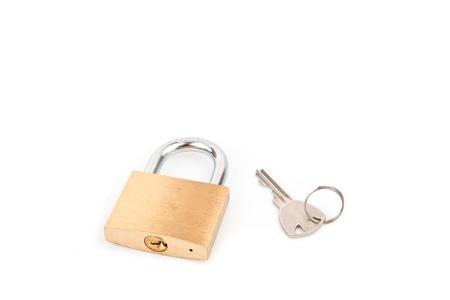 Padlock and key against white background Stock Photo - 16068874