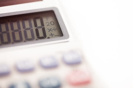 sums: Calculator close up on white background Stock Photo