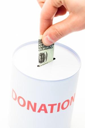 contributing: Hand donating money to charity