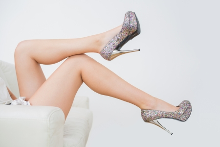 legs heels: Close-up of woman trying high heels Stock Photo