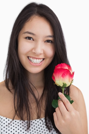 Smiling woman with rose wearing polka dots photo