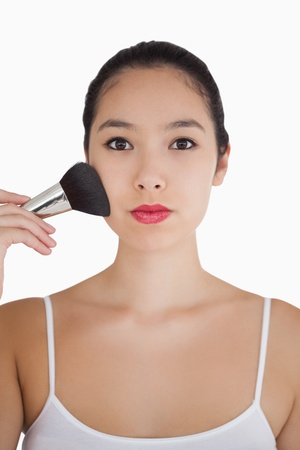 bristle: Woman using large powder bristle brush