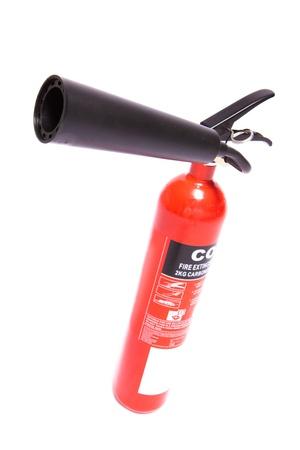 tilt: Red fire extinguisher on a tilt