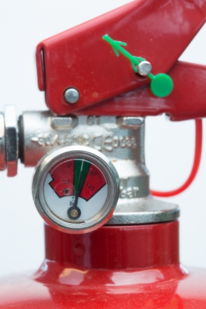 compressed air hose: Close up of top of fire extinguisher with gauge