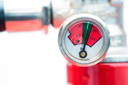 pressurized: Close up of safety gauge of fire extinguisher Stock Photo