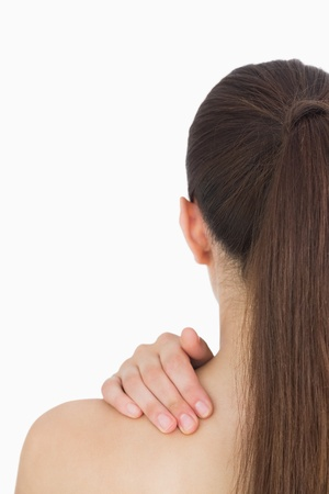 Woman having long hair while touching her shoulder