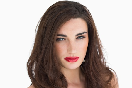 Woman with red lips and brown long hair staring at camera photo