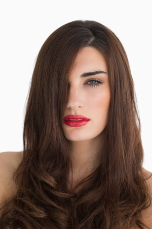 Brunette with red lips having long brown hair photo