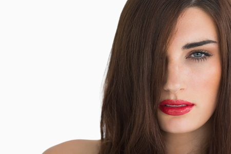 out of context: Woman with red lips and long hair on white background Stock Photo