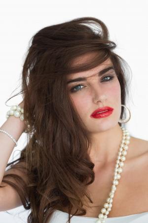 Glamorous brunette dishevelling her hair