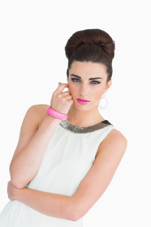 Woman with pink lips and a beehive dressed in the mod style photo