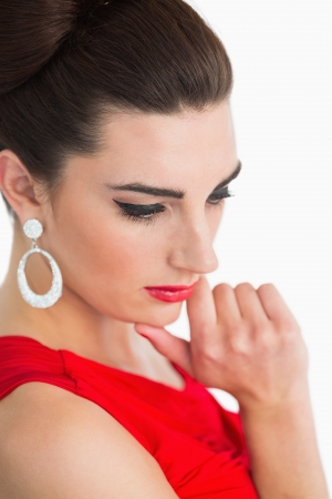 Woman wearing red dress with red lips photo