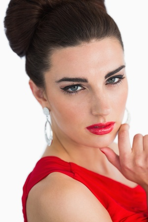 Woman with red lips and red red dress looking at camera photo