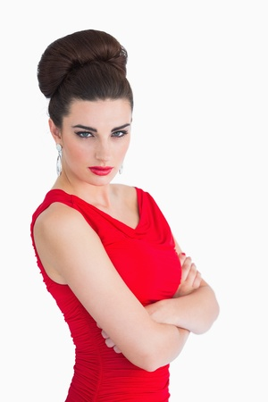 Glamorous woman in red dress having arm crossed photo