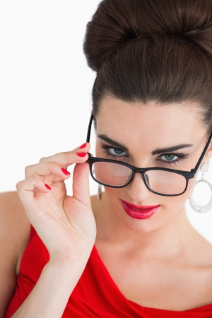 Glamorous woman wearing glasses and red dress photo