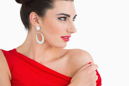 Glamorous woman in red dress looking away photo