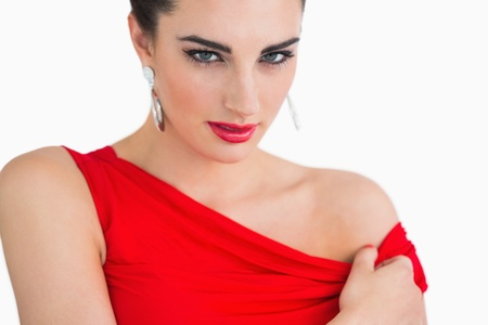 Woman with red dress and red lips looking serious photo