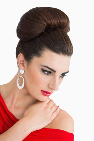 Glamorous woman looking down while wearing a red dress photo