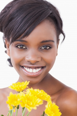 Woman holding yellow flowers while smiling  photo