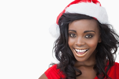 Woman wearing a Santa Claus hat smiling  photo