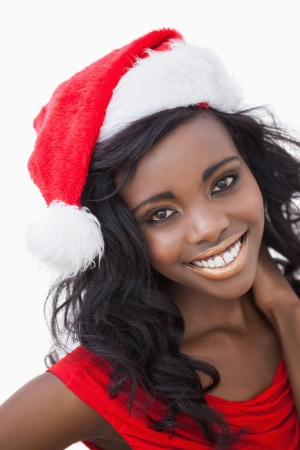 Woman wearing red dress and Santa Claus hat while smiling  photo