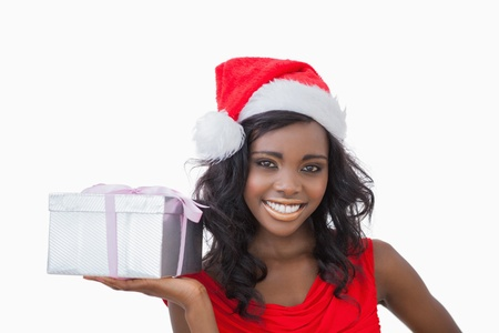 Woman standing while holding a Christmas present  Stock Photo - 16074808