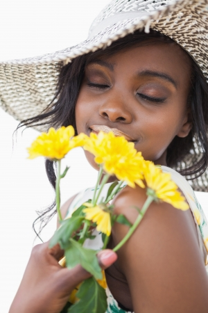Woman smelling yellow flowers with eyes closed  photo