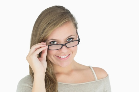tilting: Beautiful woman tilting down glasses Stock Photo