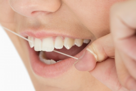 health fair: Close up of mouth and dental floss in the white background