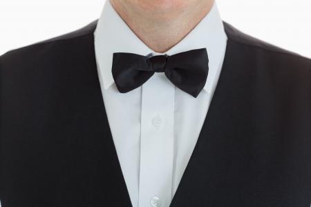 lazo negro: close-up de un traje de camarero llevar con corbata de lazo Foto de archivo