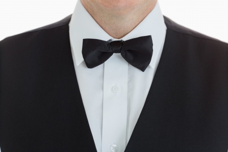 black tie: close-up of a waiter wearing suit with bow tie