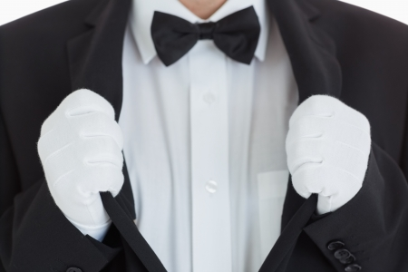 Waiter clinging at his jacket in front of camera Stock Photo - 16076249