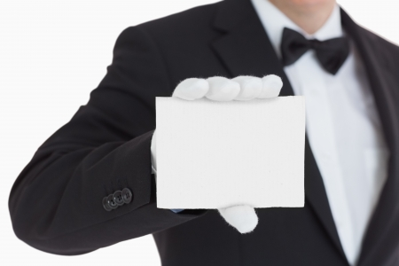 Waiter showing us a paper in front of camera Stock Photo - 16076033