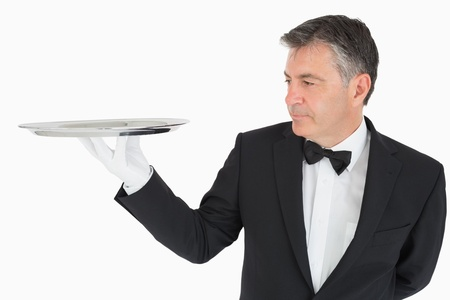 Man holding an empty silver tray  photo